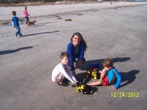 mom and boys beach
