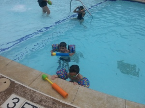 both boys in pool
