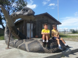 boys sitting on snake