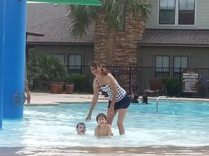 mom and boys pool