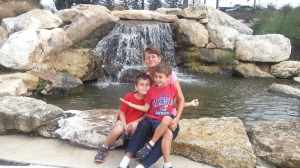 mom and boys bass pro waterfall